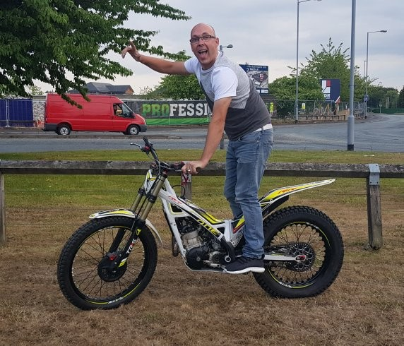Christon taking delivery of his TRS 300 trials bike